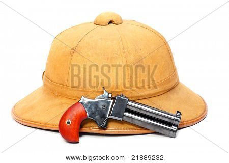 Necessary articles for happy holidays in tropical bush. Tropical cork helmet and 2 shot .45 cal derringer hand gun.