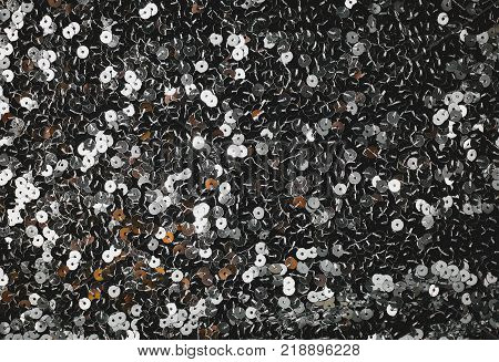 background of silvery sequins. Bright Christmass background