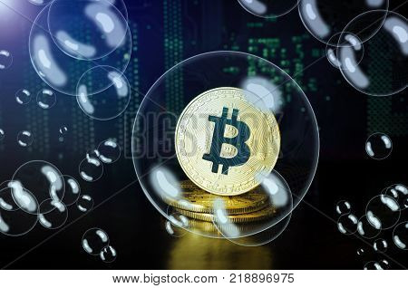 Bitcoin in a soap bubble. Cryptocurrency physical golden bitcoin coins.