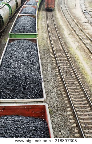 Aerial view on wagons with black coal. Coal transportation