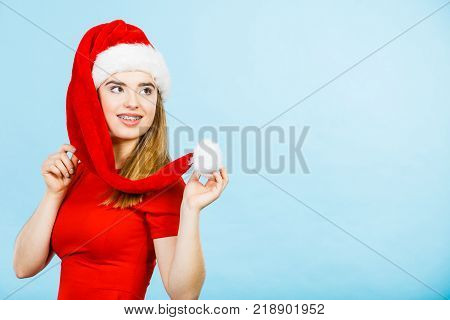 Xmas seasonal clothing winter christmas concept. Young smiling positive woman wearing Santa Claus helper costume