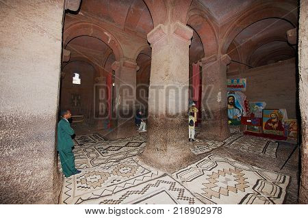 LALIBELA, ETHIOPIA - JANUARY 27, 2010: Unidentified people visit largest rock-hewn church Bet Medhane Alem (House of the Saviour of the World) in Lalibela, Ethiopia. UNESCO World Heritage site.