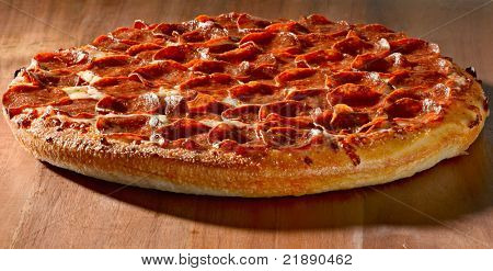 wide shot of a whole pepperoni pizza