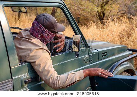 Safari ranger or wildlife guide of Ranthambore national park in gypsy vehicle or SUV, Rajastan, India.