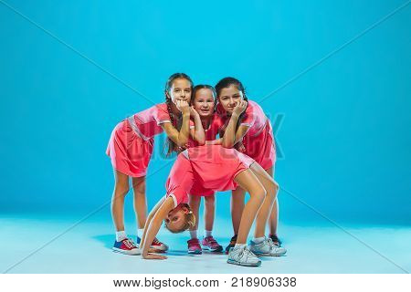The kids dance school, ballet, hiphop, street, funky and modern dancers on blue studio background