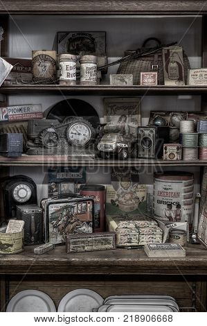 HASTINGS MN - JULY 30 2017: Vintage toys and supplies displayed on shelving in antique store. General stores were often used for communities to acquire toys and supplies during the 18 and 1900s.