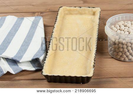 Cooking Process Of Homebaked Tart. Raw Dough In Baking Tray. Ceramic Baking Beans