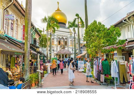 Visitors Walk Around Masjid Sultan At Mosque Street In Singapore