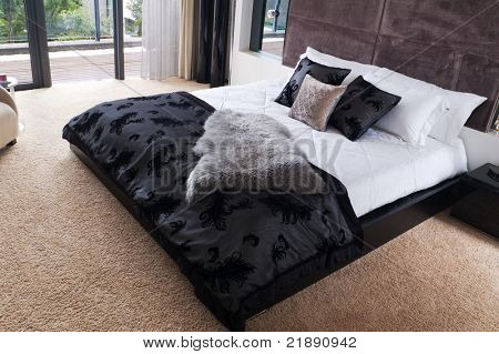 Luxury hotel room interior with king-size bed
