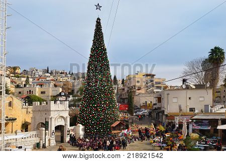 NAZARETH, ISRAEL - DECEMBER 18: People celebrate the Christmas, near the Greek Orthodox Church of the Annunciation in Nazareth, Israel, december 18, 2017