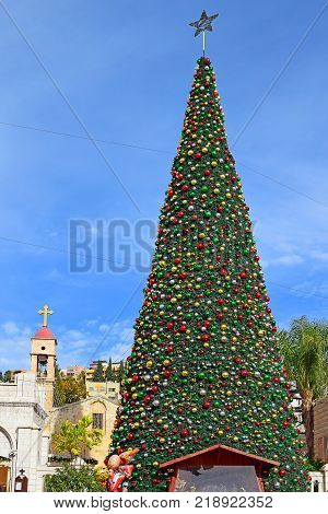 view of the Greek Orthodox Church of the Annunciation with Christmas decorations and a Christmas tree in Nazareth, Israel