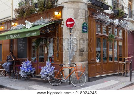 Paris, France-December 17, 2017: the traditional French cafe Au Bougnat decorated for Christmas located near Notre Dame cathedral, on the isle de la Cite, in the 4th district of Paris.