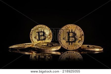 Pile of bitcoins, cryptocurrecny of future. Concept of e-commerce, e-business and finance. Isolated on blacke background