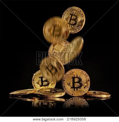 Flying bitcoins in motion, cryptocurrecny of future. Concept of e-commerce, e-business and finance. Isolated on blacke background