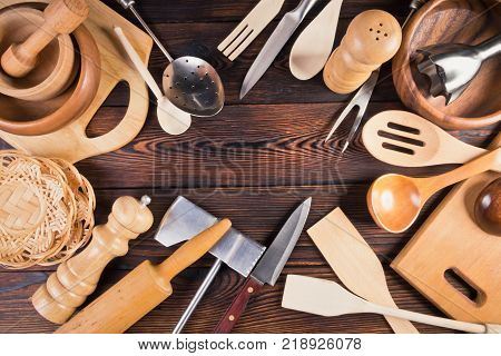 Still life from home kitchen utensils on a dark wooden background. View from above