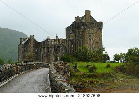 View of Eilean Donan Castle from Scotland. Ancient medieval castle. Scottish landscape