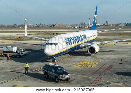 BOLOGNA ITALY - FEBRUARY 2016: Ryanair jetliner arriving at the Bologna airport Italy. Ryanair Ltd. is an Irish low-cost airline headquartered in Swords Dublin Ireland.