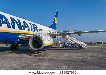 BOLOGNA ITALY - FEBRUARY 2016: Ryanair jetliner waiting for the passengers at the Bologna airport Italy. Ryanair Ltd. is an Irish low-cost airline headquartered in Swords Dublin Ireland.