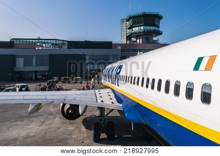BOLOGNA ITALY - FEBRUARY 2016: Passengers boarding Ryanair jetliner at the Bologna airport Italy to Bucharest Romania. Ryanair Ltd. is an Irish low-cost airline headquartered in Swords Dublin Ireland.
