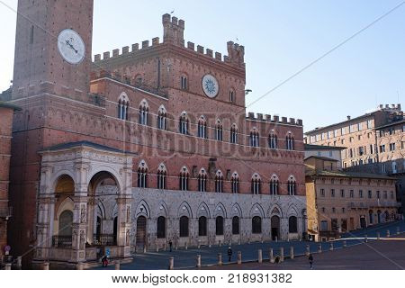 Day view of Campo Square (Piazza del Campo) Siena Palazzo Pubblico and Mangia Tower (Torre del Mangia) in Siena Tuscany Italy.