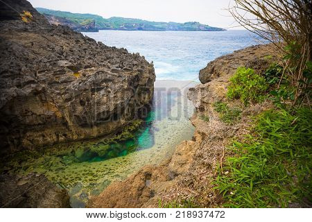 Angel's Billabong is natural infinity pool on the island of Nusa Penida next to Bali, Indonesia