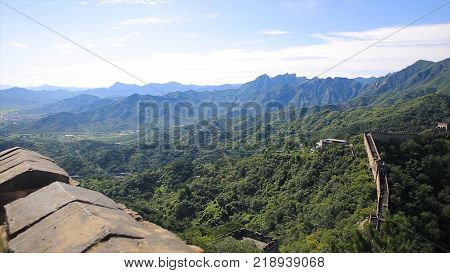 Panorama of Chinese great wall with nature landscape background. China Great wall, hiking route around Simatai section, one of the most impressive and less touristic part of the Great Wall. Great Wall sunset over mountains in Beijing, China.