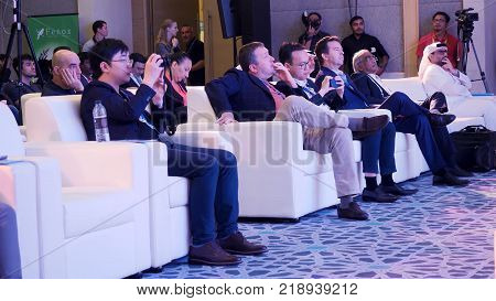 Hong Kong, China - December 11, 2017: Audience in the lecture hall. Audience Listening To Presentation At Conference. Speaker Giving a Talk at Business Meeting. Audience in the conference hall
