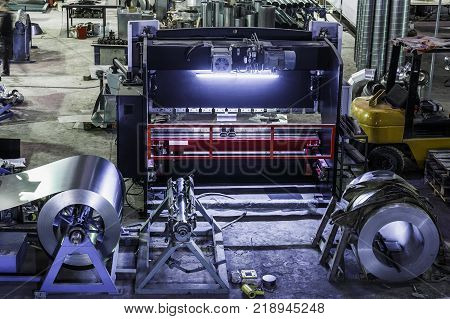 Industrial workshop or hangar on production of ventilation systems. Metalworking factory abstract background with lots of equipment and machinery, toned