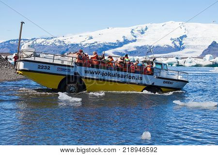 Jokusarlon, Iceland, July 7th 2014. - Tourists wearing life vests ride on amphibian vehicle named 'Dreki' on glacial lake in southeastern part of Iceland.