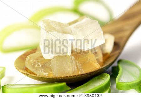 Aloe Vera Gel in Wooden Spoon with Aloe Vera Leaves on White Background. Aloe Vera gel almost use in food medicine and beauty industry.