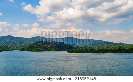 Mountain, lake and blue sky with white clouds in Thailand