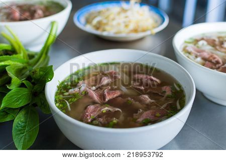Pho Bo, plate with vietnamese soup noodle with beef