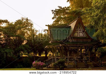 Chinese style pavilion and Tree of a park in Thailand.