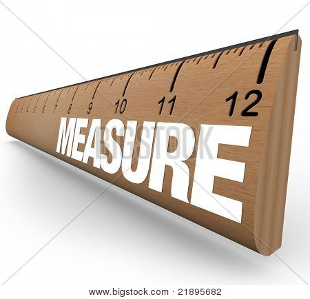 A wooden ruler with the word Measure, illustrating the need to do measurements to quantify objects or processes