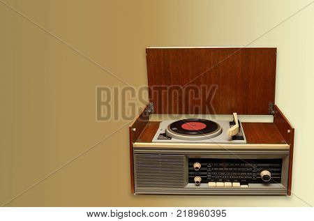 old tube radio audio equipment for playing records and listening to the radio on a light background