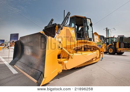 MOSCOW RUSSIA - JUNE 02: Yellow diesel bulldozer on display at Moscow International exhibition Const