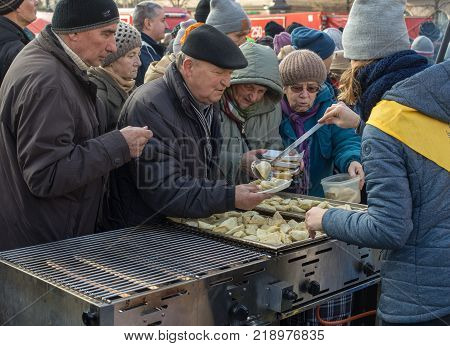 Cracow Poland - December 17 2017: Christmas Eve for poor and homeless on the Main Square in Cracow. Every year the group Kosciuszko prepares the greatest eve in the open air in Cracow. Poland