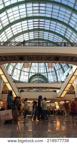 DUBAI, UNITED ARAB EMIRATES - MARCH 30th, 2014: Shoppers at Mall of the Emirates in Dubai. Mall of the Emirates is a shopping mall in the Al Barsha district.