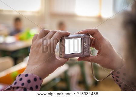 woman photographing with camera indoors interior and woman photographing with an old camera indoors interior and people.