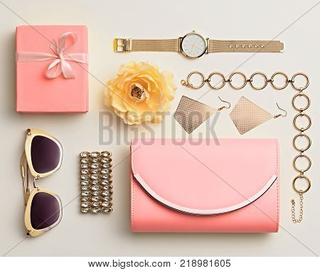 Fashion. Woman Accessories Spring Set. Trendy Watch, Summer Sunglasses, Glamour fashion Pink Clutch. Flower. Layout. Luxury spring lady. Spring Vanilla Pink Color