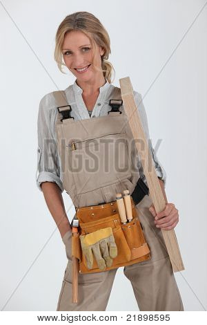 blonde handywoman holding boards