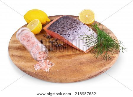 red fish with lemon pepper and parsley isolated on white background