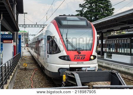 Locarno Switzerland - May 28 2016: A passenger train of the TILO (Regional Train Ticino Lombardia) at a platform of the Locarno railway station.