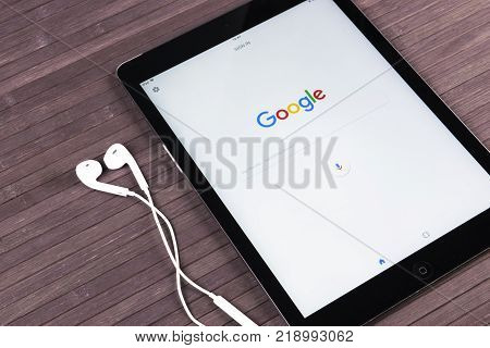 Sankt-Petersburg Russia December 20 2017: Google start web homepage page on display of Apple iPad Pro. Google is an American multinational corporation with Internet related services and products