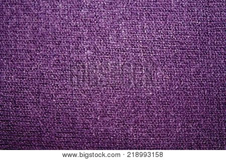 Violet fabric texture useful as a background