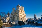 Curtea de Arges monastery in winter, Romania. Curtea de Arges Monastery is known because of the legend of architect master Manole. It is a landmark in Wallachia, medieval Romania. poster
