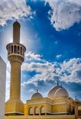 Minaret of a mosque in Bur Dubai backlit by the sun. HDR image poster