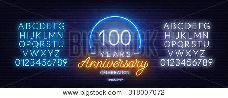 100th Anniversary Celebration Neon Sign On Dark Background.