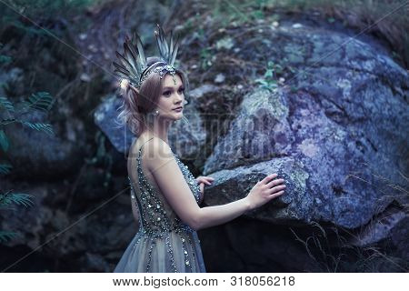 Fairytale Girl In Beautiful Stones. Stones In The Moss.