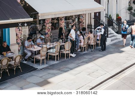 London, Uk - July 29, 2019: High Angle View Of People Sitting At The Outdoor Tables Of A Cafe In Kni